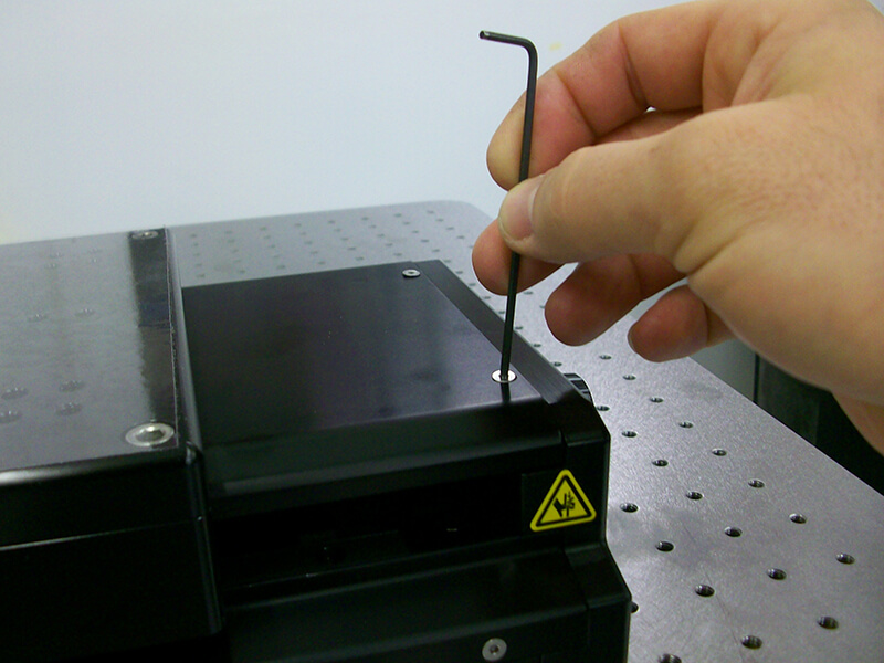 Removing the cover off a linear stage to perform maintenance
