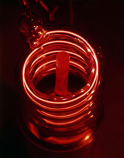 The first laser which is a ruby rod surrounded by a flashlamp